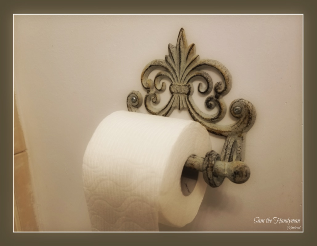 Vintage toilet paper holder installation